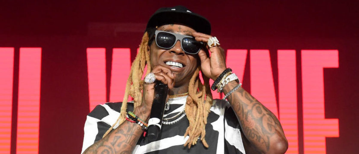 RAPPER LIL WAYNE THREATENS TO SHOOT CONCERTGOERS