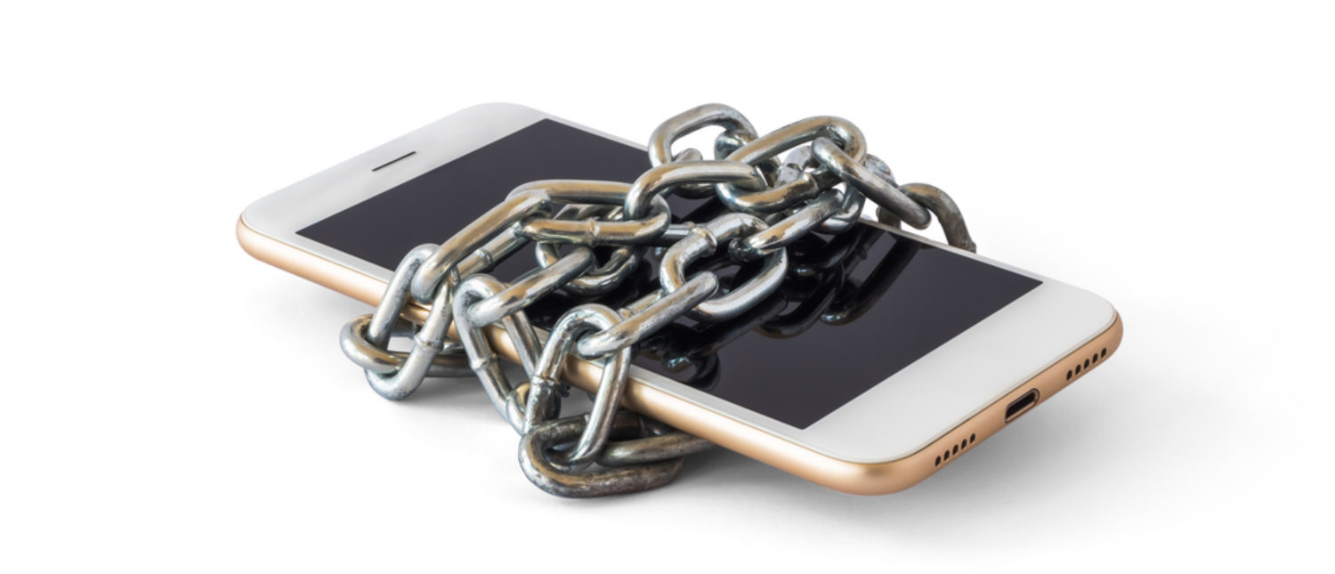 A smartphone locked with chains. [Shutterstock - Poravute Siriphiroon]