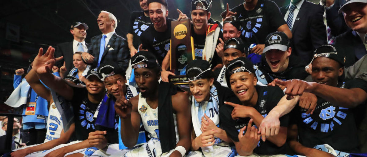 GLENDALE, AZ - APRIL 03:  The North Carolina Tar Heels celebrate after defeating the Gonzaga Bulldogs during the 2017 NCAA Men's Final Four National Championship game at University of Phoenix Stadium on April 3, 2017 in Glendale, Arizona. The Tar Heels defeated the Bulldogs 71-65.  (Photo by Ronald Martinez/Getty Images)
