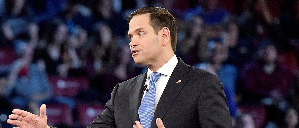 Marjory Stoneman Douglas student Cameron Kasky (L) asks Senator Marco Rubio if he will continue to accept money from the NRA during a CNN town hall meeting, at the BB&T Center, in Sunrise, Florida, U.S. February 21, 2018. REUTERS/Michael Laughlin/Pool