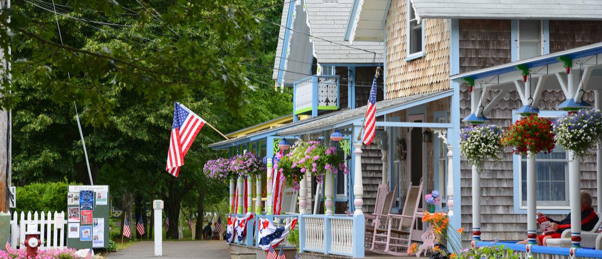 MARTHA'S VINEYARD, MA, USA - JULY. 3, 2015: Carpenter Gothic Cottages with Victorian style, gingerbread trim in Wesleyan Grove, town of Oak Bluffs on Martha's Vineyard, Massachusetts, USA. Shutterstock/ jiawangkun
