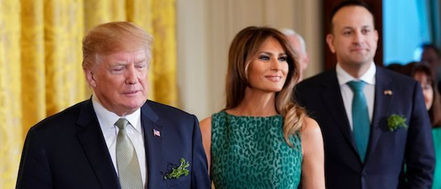 US President Donald Trump (L), US first lady Melania Trump (C) and Ireland's Prime Minister Leo Varadkar walk into the East Room of the White House March 15, 2018 in Washington, DC. / AFP PHOTO / Mandel NGAN (Photo credit should read MANDEL NGAN/AFP/Getty Images)