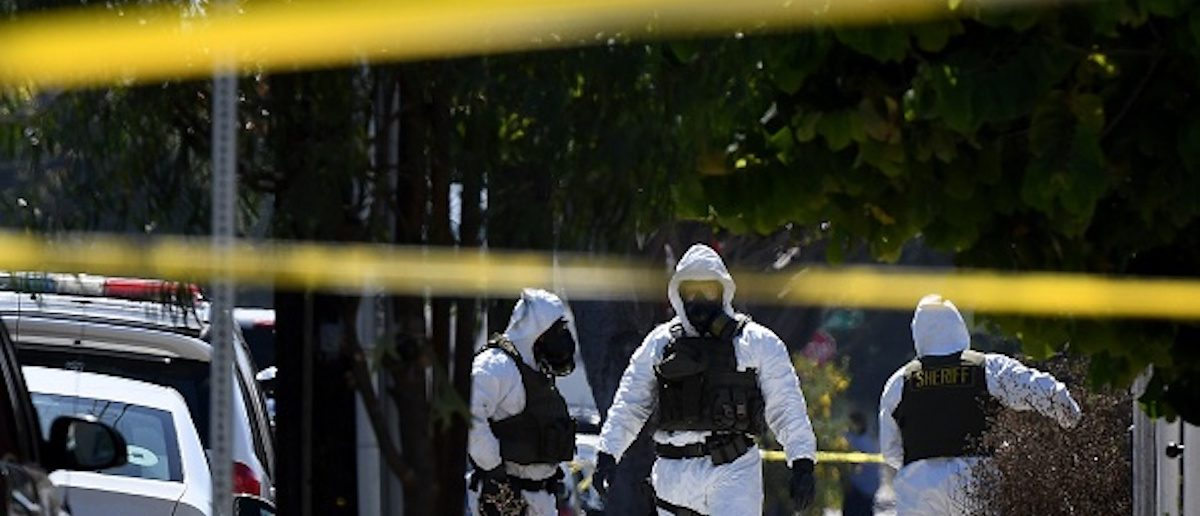 Members of the Los Angeles County Sheriff's Department bomb and hazmat squad, search a house where a large amount of military ordnance including artillery shells and grenades was found in Lawndale, California on September 29, 2017. Up to 100 local residents were evacuated to a nearby school, during the 14 hour operation to remove the ordnance from the residential property and one person was arrested in the raid. / AFP PHOTO / Mark RALSTON (Photo credit should read MARK RALSTON/AFP/Getty Images)