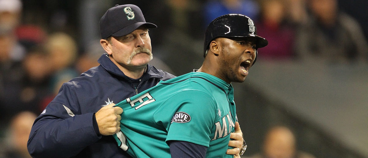 SEATTLE - MAY 06: Milton Bradley #15 of the Seattle Mariners is restrained by manager Eric Wedge #22 after being ejected from the game against the Chicago White Sox at Safeco Field on May 6, 2011 in Seattle, Washington. (Photo by Otto Greule Jr/Getty Images)