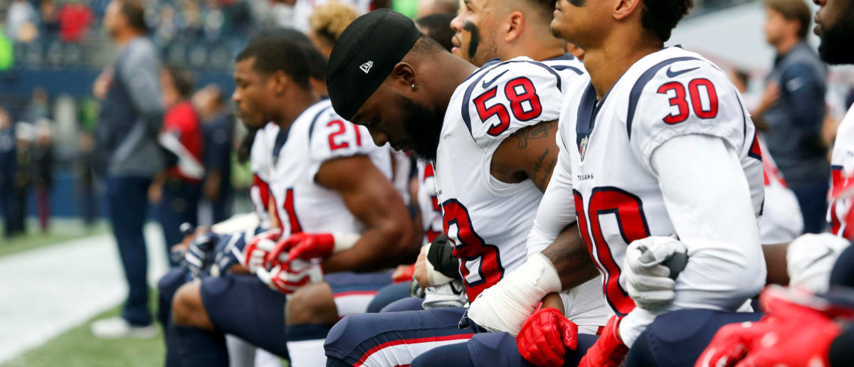 Oct 29, 2017; Seattle, WA, USA; Houston Texans linebacker Lamarr Houston (58) and cornerback Kevin Johnson (30) kneel during the national anthem before kickoff against the Seattle Seahawks at CenturyLink Field. Mandatory Credit: Joe Nicholson-USA TODAY Sports