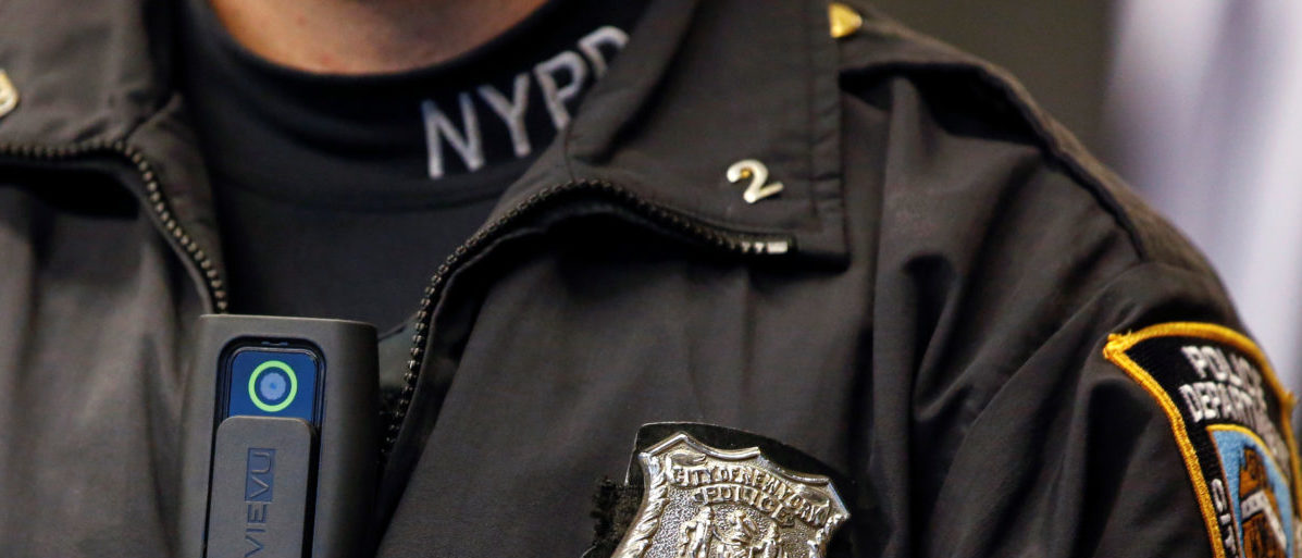 FILE PHOTO - A police body camera is seen on an officer during a news conference on the pilot program of body cameras involving 60 NYPD officers dubbed 'Big Brother' at the NYPD police academy in the Queens borough of New York, December 3, 2014.  REUTERS/Shannon Stapleton/File Photo