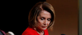 House Democratic leader Nancy Pelosi gestures to the gavel she used when she became the first female Speaker of the House of Representatives, during a Donation Ceremony at the Smithsonian Museum in Washington, DC, U.S., March 7, 2018. REUTERS/Brian Snyder | How Many Dems Still Support Nancy Pelosi