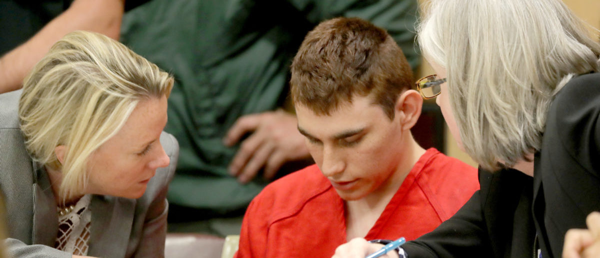 FILE PHOTO: Nikolas Cruz, facing 17 charges of premeditated murder in the mass shooting at Marjory Stoneman Douglas High School in Parkland, appears in court for a status hearing in Fort Lauderdale, Florida, U.S. February 19, 2018. REUTERS/Mike Stocker/Pool