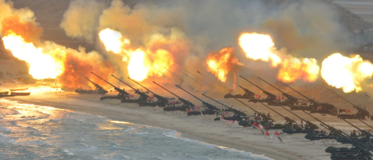Artillery pieces are seen being fired during a military drill at an unknown location, in this undated photo released by North Korea's Korean Central News Agency (KCNA) on March 25, 2016. REUTERS/KCNA/File Photo