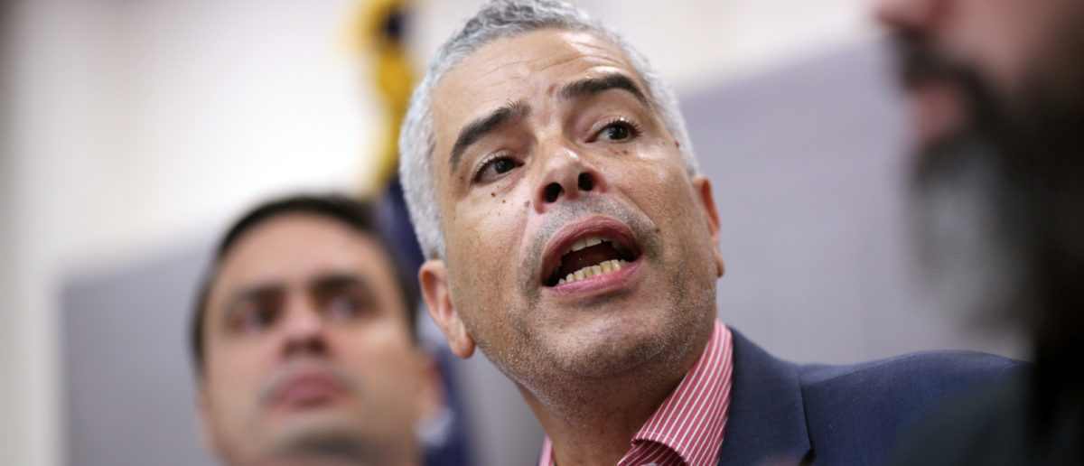 Ricardo Ramos (C), executive director of the Electric Power Authority of Puerto Rico (PREPA), addresses the media during a news conference, in San Juan, Puerto Rico November 2, 2017. REUTERS/ Alvin Baez