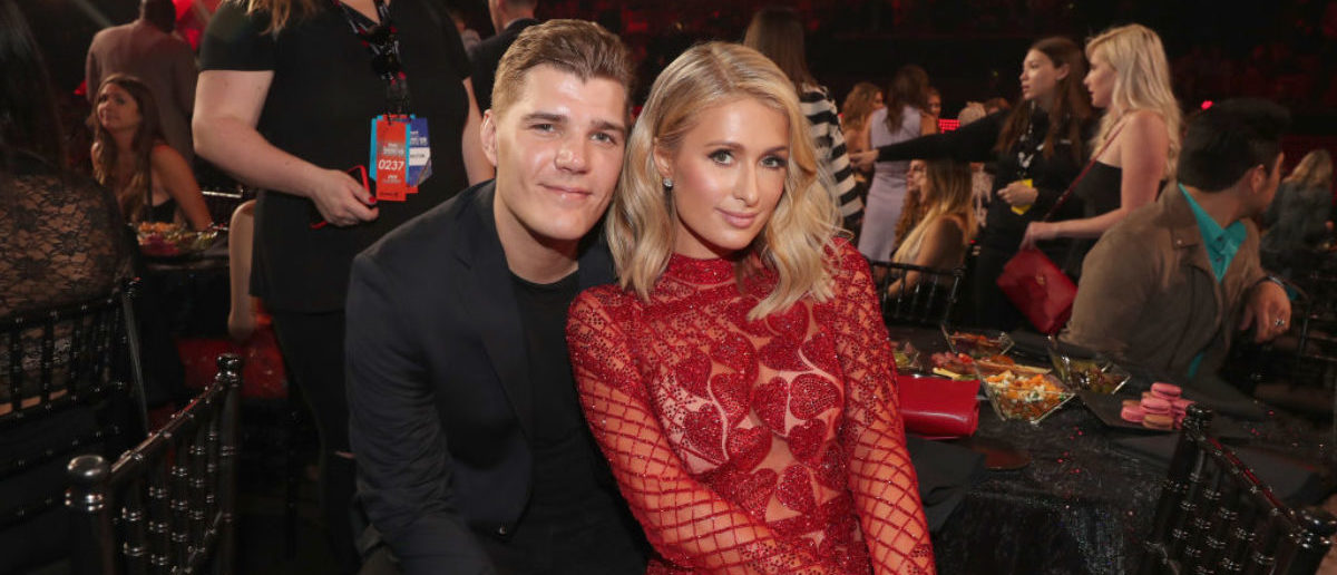 INGLEWOOD, CA - MARCH 11: Chris Zylka (L) and Paris Hilton performs onstage during the 2018 iHeartRadio Music Awards which broadcasted live on TBS, TNT, and truTV at The Forum on March 11, 2018 in Inglewood, California. (Photo by Christopher Polk/Getty Images for iHeartMedia)