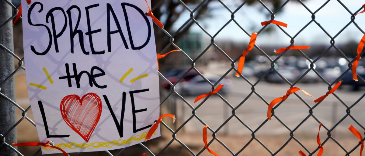 Memorial ribbons are tied on the fence outside Columbine High School after students placed them there during a National School Walkout to honor the 17 students and staff members killed at Marjory Stoneman Douglas High School in Parkland, Florida, in Littleton, Colorado, U.S. March 14, 2018. REUTERS/Rick Wilking | Networks Cheer On Anti-Gun Protest