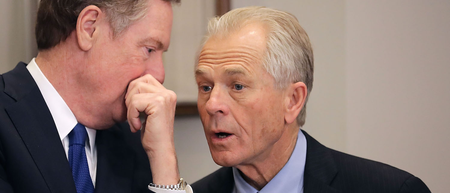 U.S. Trade Representative Robert Lighthizer (L) and White House National Trade Council Director Peter Navarro talk before President Donald Trump signs the 'Section 232 Proclamations' on steel and aluminum imports (Photo: Chip Somodevilla/Getty Images)
