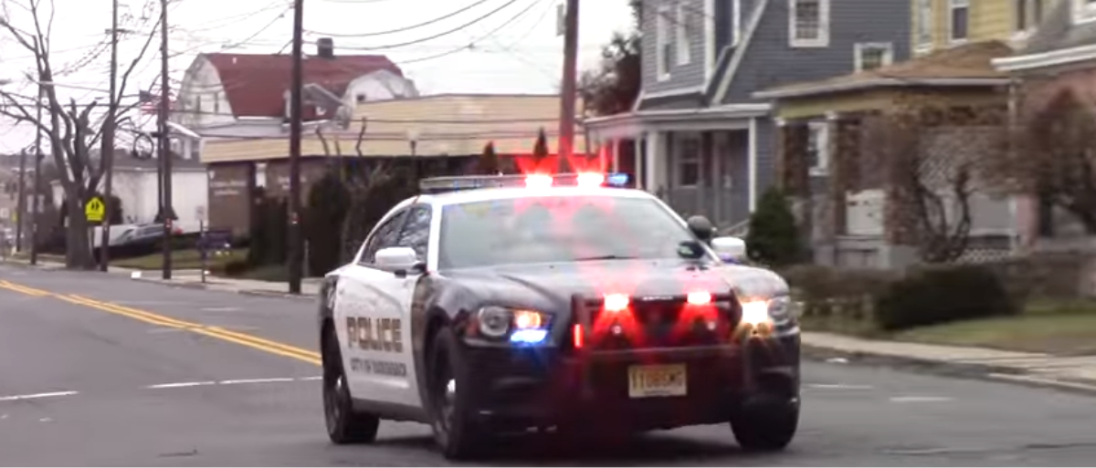 A police car responds to an emergency. (Photo Credit: YouTube/Demonracer2)