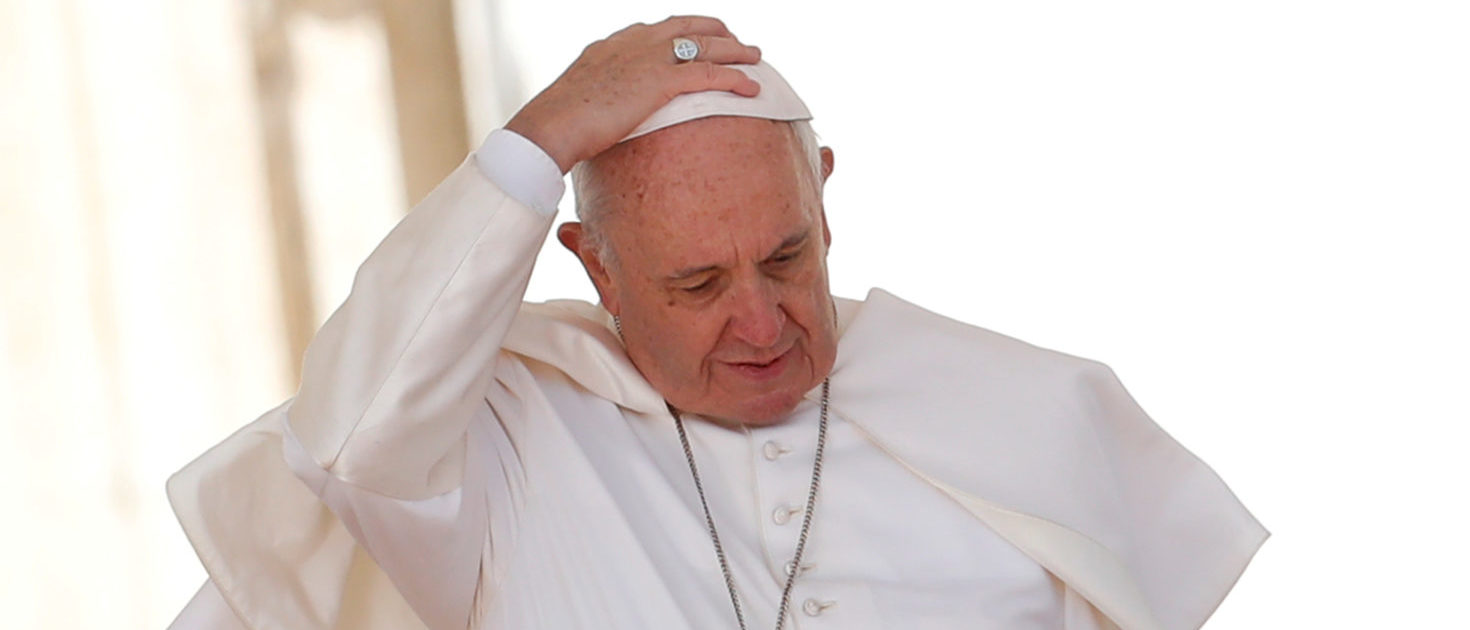 FILE PHOTO: Pope Francis touches his skull cap during the Wednesday general audience in Saint Peter's square at the Vatican, March 14, 2018. REUTERS/Remo Casilli/File Photo | Vatican Denies Pope Doubts Hell Exists
