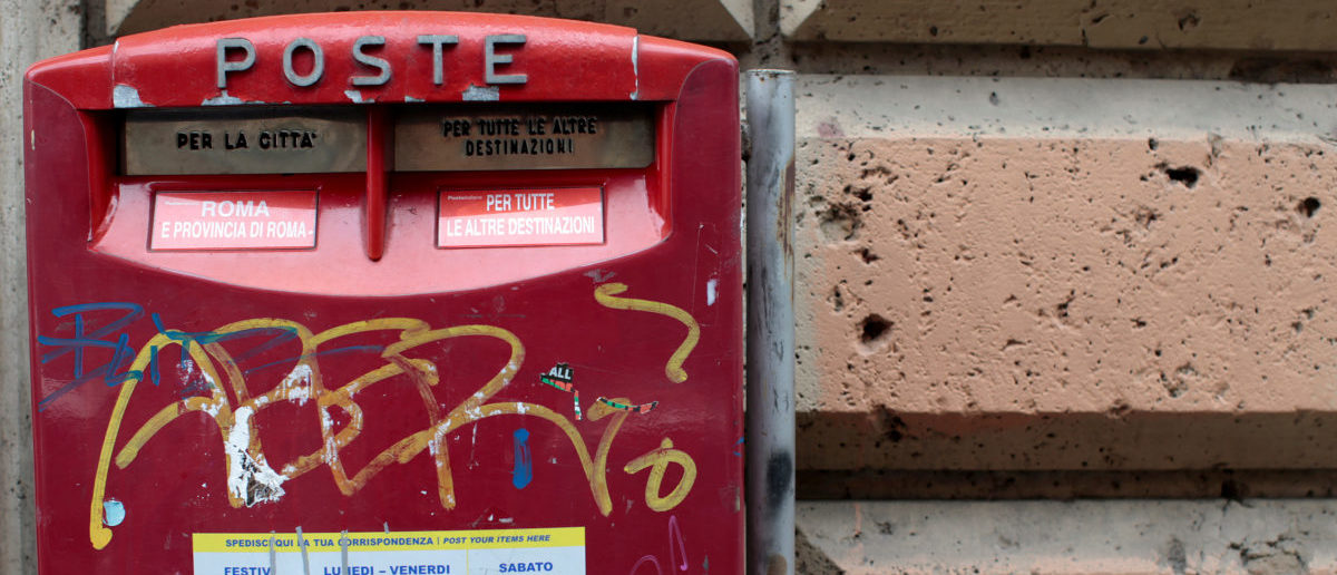 FILE PHOTO: A letterbox is seen outside a post office in Rome, Italy, January 24, 2014. REUTERS/Tony Gentile