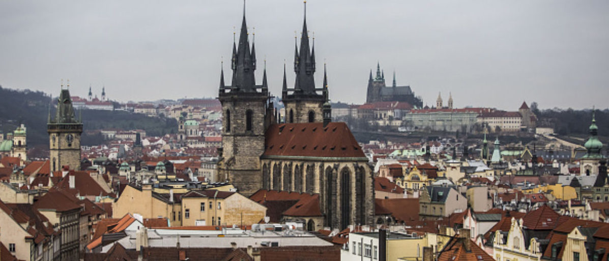 Prague castle, top right, sits on the city skyline beyond rooftops in the historical old district of Prague, Czech Republic, on Tuesday, Dec. 29, 2015. Capital is flowing into Czech assets even as the Finance Ministry sells bonds at negative yields. Photographer: Martin Divisek/Bloomberg via Getty Images