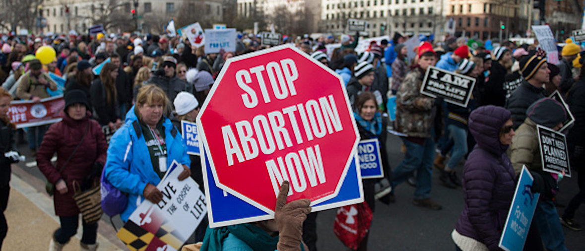 Pro-life demonstrators march towards the US Supreme Court during the 44th annual March for Life in Washington, DC, on January 27, 2017. Anti-abortion advocates descended on the US capital on Friday for an annual march expected to draw the largest crowd in years, with the White House spotlighting the cause and throwing its weight behind the campaign. / AFP / Andrew CABALLERO-REYNOLDS (Photo credit should read ANDREW CABALLERO-REYNOLDS/AFP/Getty Images)