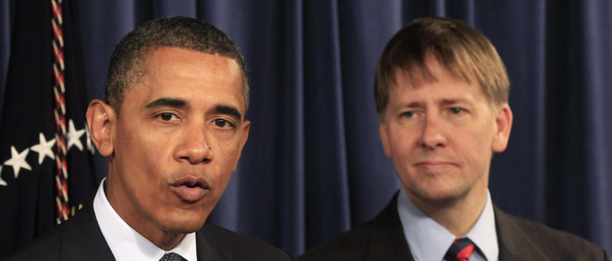 U.S. President Barack Obama speaks as Richard Cordray (R), his appointed head of the Consumer Financial Protection Bureau (CFPB), stands at his side during Obama's visit to the CFPB in Washington January 6, 2012. Cordray ordered staff back into the building while construction was underway | 'Fumes' Sicken CFPB Employees | REUTERS/Kevin Lamarque  (UNITED STATES - Tags: BUSINESS POLITICS)