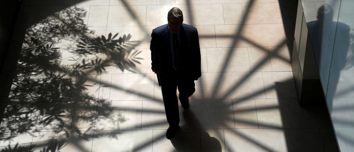 A man walks through the atrium of a building in Denver, Colorado, U.S. August 9, 2017. REUTERS/Rick Wilking