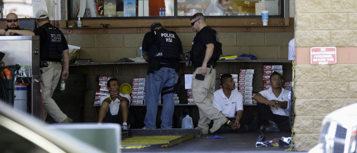 The ICE Homeland Security Investigations agents detain workers at Danny's Family Car Wash in Phoenix, Arizona August 17, 2013. The agents raided 16 different Danny's Family Car Wash locations across the Phoenix metropolitan area in a crackdown on illegal immigration, local media reported.   REUTERS/Joshua Lott (UNITED STATES - Tags: CRIME LAW SOCIETY IMMIGRATION POLITICS) - GM1E98I0GZC01