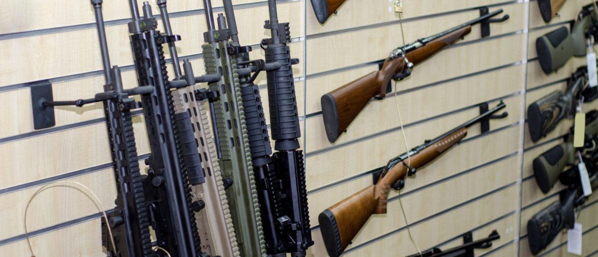 Rack of rifles - ShutterStock By Lutsenko_Oleksandr | LA Times: Did Newtown Bankrupt Remington?