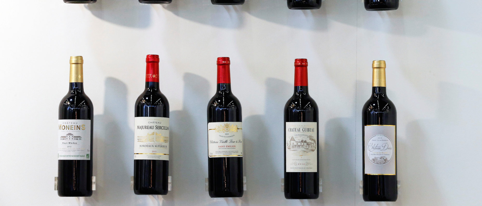Bottles of red wine are displayed at the wine fair Vinexpo in Bordeaux, southwestern France, June 19, 2017. REUTERS/Regis Duvignau