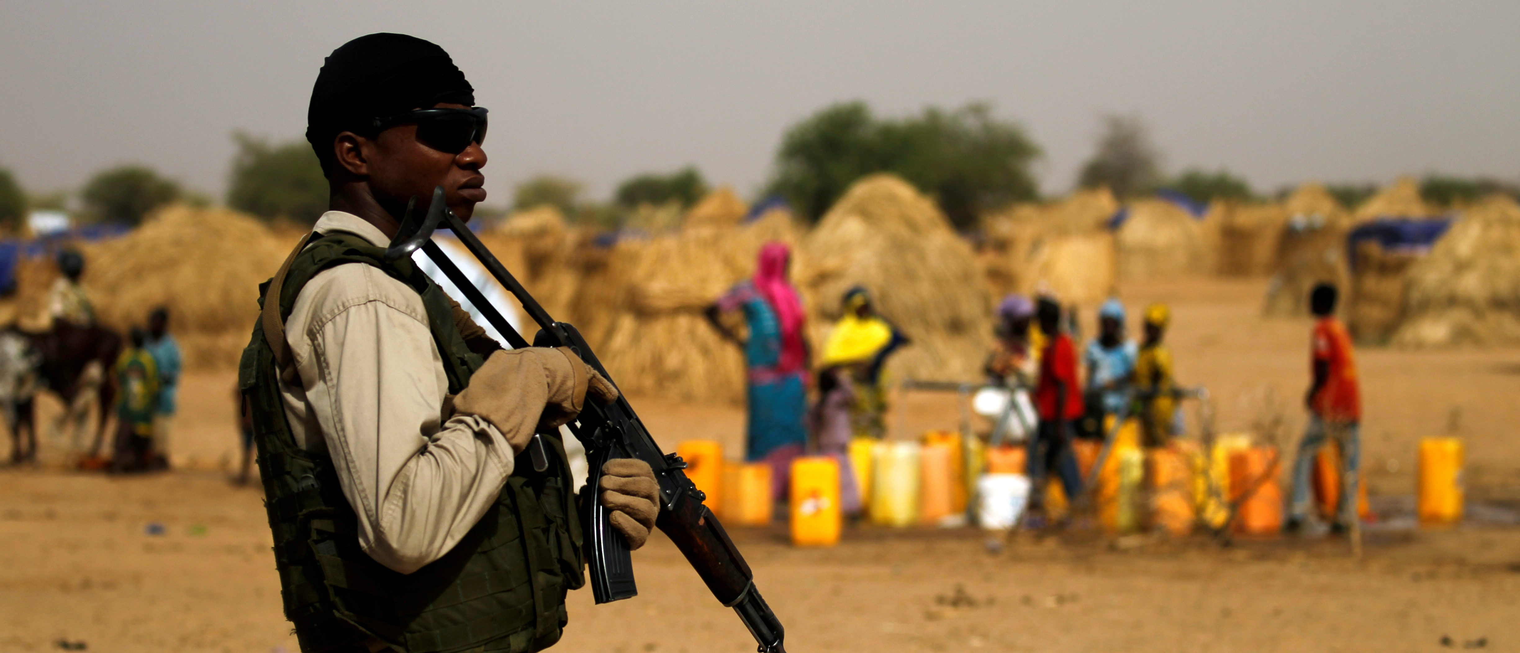 FILE PHOTO: A Nigerien soldier stands guard in a camp of the city of Diffa during the visit of Niger's Interior Minister Mohamed Bazoum following attacks by Boko Haram fighters in the region of Diffa, Niger June 18,2016. REUTERS/Luc Gnago - D1AETKPXWZAA/File Photo - RC14FEC39AD0