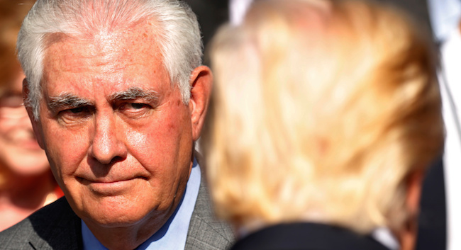 Secretary of State Rex Tillerson looks toward President Donald Trump during the 9/11 observance at the National 9/11 Pentagon Memorial in Arlington, Virginia, September 11, 2017. REUTERS/Kevin Lamarque