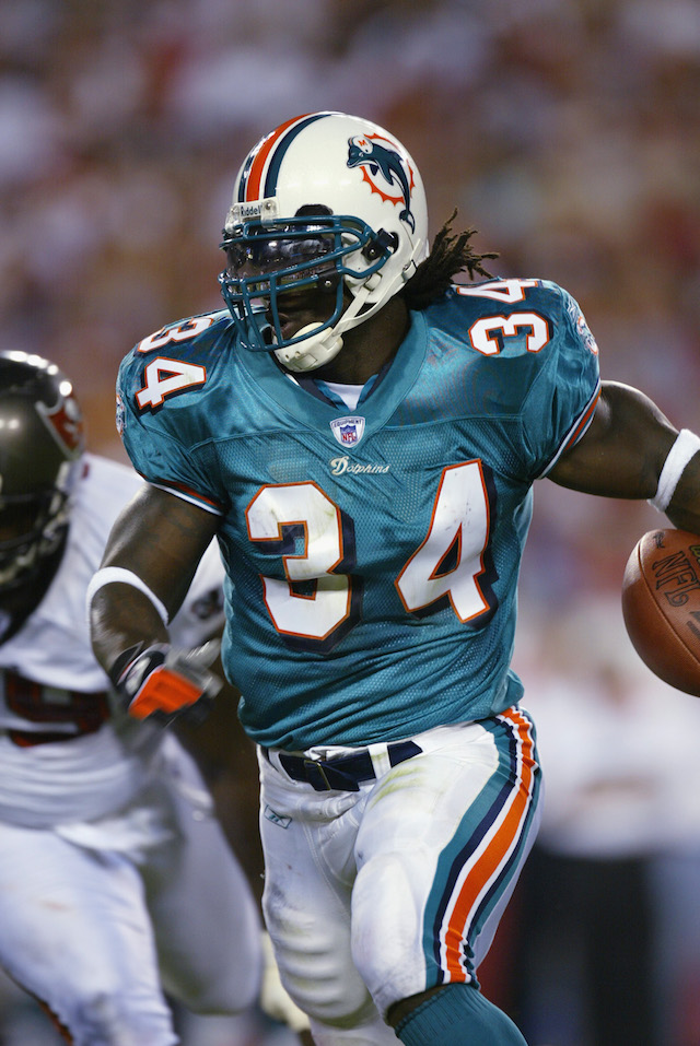 TAMPA, FL - AUGUST 12: Running Back Ricky Williams #34 of the Miami Dolphins runs for short yardage against the Tampa Bay Buccaneers in the first half on August 12, 2002 at Raymond James Stadium in Tampa, Florida. The Buccaneers defeated the Dolphins 14-10. (Photo By Eliot Schechter/Getty Images)