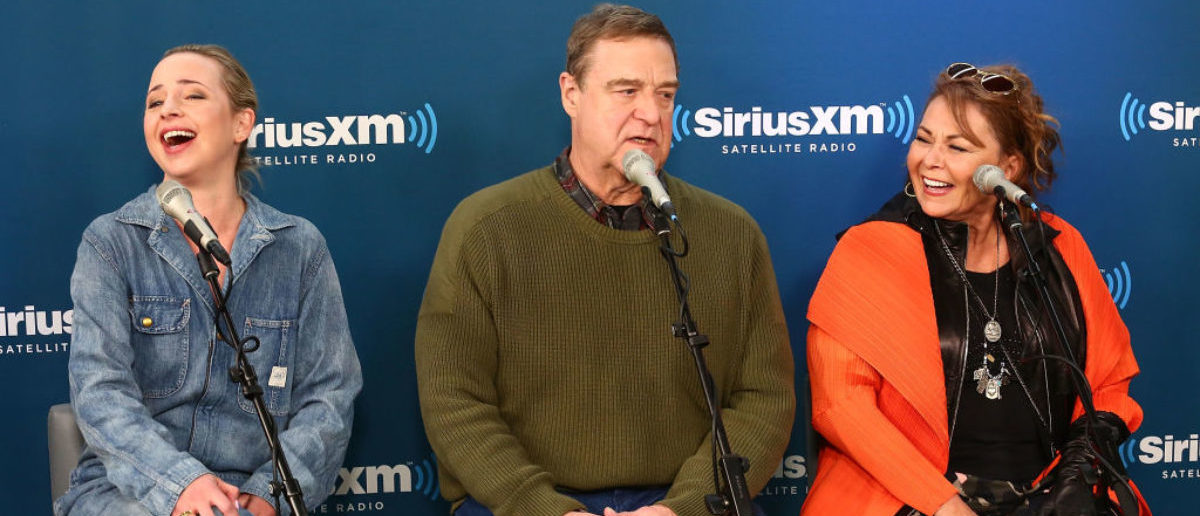 NEW YORK, NY - MARCH 27: (L-R) Actors Lecy Goranson, John Goodman and Roseanne Barr speak during SiriusXM's Town Hall with the cast of Roseanne on March 27, 2018 in New York City. (Photo by Astrid Stawiarz/Getty Images for SiriusXM)