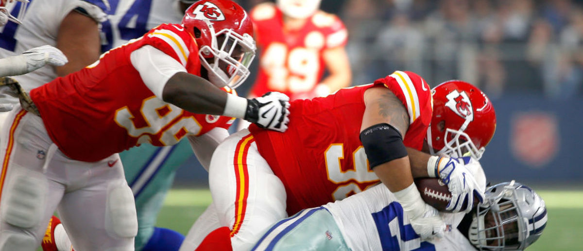 ARLINGTON, TX - NOVEMBER 05:  Roy Miller #98 of the Kansas City Chiefs tackles Ezekiel Elliott #21 of the Dallas Cowboys in the second quarter of a football game at AT&T Stadium on November 5, 2017 in Arlington, Texas.  (Photo by Ron Jenkins/Getty Images)
