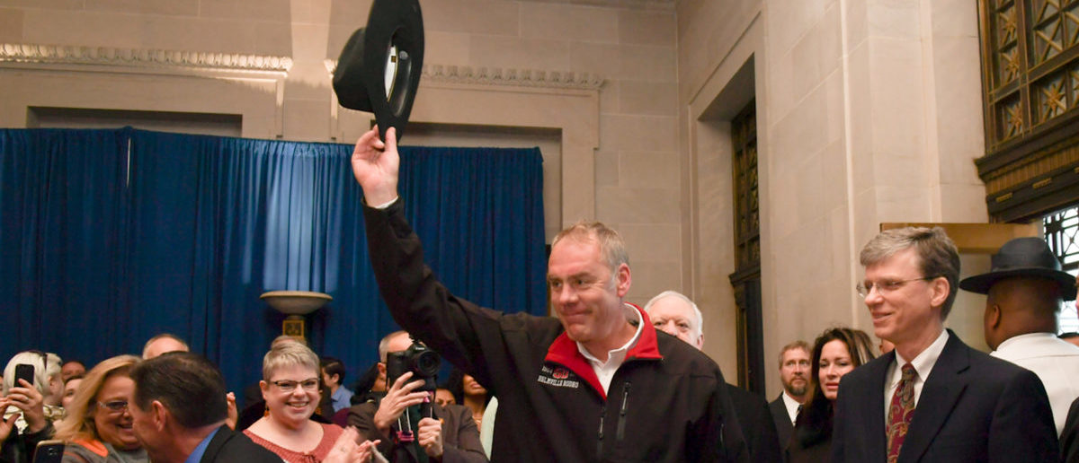 New Interior Secretary Ryan Zinke tipping his cowboy hat after riding in on horseback with a U.S. Park Police horse mounted unit reporting for his first day of work at the Interior Department in Washington
