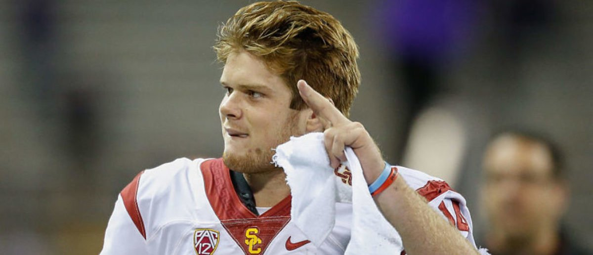 SEATTLE, WA - NOVEMBER 12: Quarterback Sam Darnold #14 of the USC Trojans waves to the crowd as he heads off the field after beating the Washington Huskies 24-13 on November 12, 2016 at Husky Stadium in Seattle, Washington. (Photo by Otto Greule Jr/Getty Images)