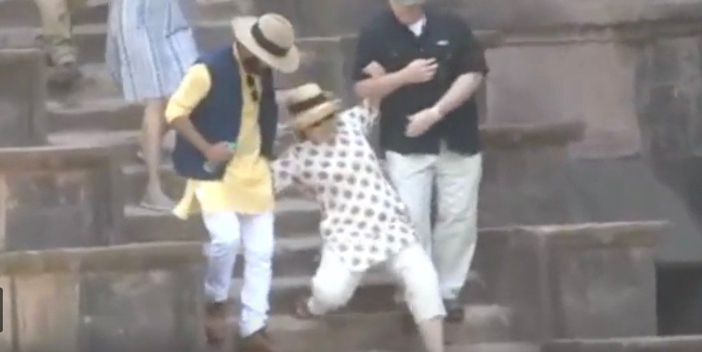 Watch: Hillary Nearly Falls Down Stairs Twice In India