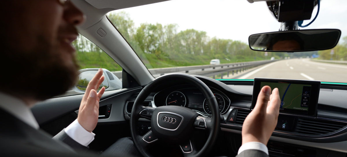 A journalist takes off the hands from the steering wheel as he sits on the driver seat of a Audi piloted driving car near Ingolstadt, southern Germany, on May 12, 2016. The piloted driving car controls lane changes and keeps distance to other cars. (Photo: ANDREAS GEBERT/AFP/Getty Images)