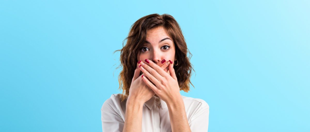 This woman is very shocked. (Shutterstock/Luis Molinero) | Teacher Suspended After Saying N-Word