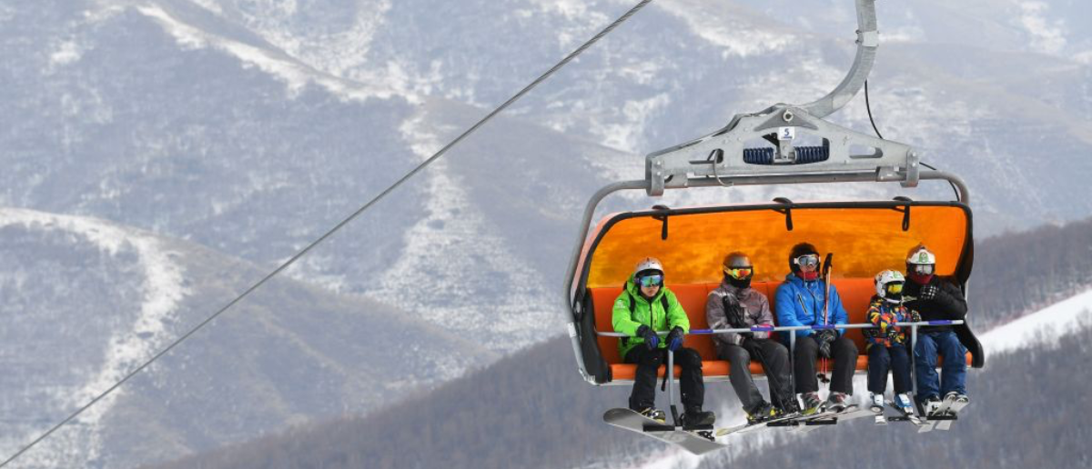 This photo taken on February 24, 2018 shows skiers and snowboarders riding a chairlift at the Genting ski field at Chongli, north of Beijing, one of the venues for events for the upcoming Winter Olympic Games in China in 2022. With the Pyeongchang, South Korea games having wrapped up on February 25, focus has turned to Beijing as China spends big to host its first Winter Olympics in 2022. (Photo: GREG BAKER/AFP/Getty Images)