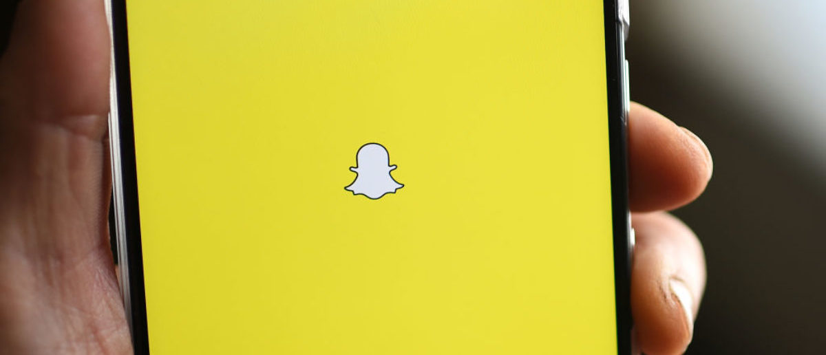 "(Alternative crop) The Snapchat logo is displayed on a mobile phone, March 1, 2017 in Glendale, California. After a dearth of technology listings in 2016, Snapchat parent Snap is set for its market debut as early as this week. The initial public offering (IPO) if successful could presage a wave of listings from the sector's so-called ""unicorns"" -- those with a valuation of at least $1 billion based on private funding sources. / AFP PHOTO / Robyn BECK (Photo credit should read ROBYN BECK/AFP/Getty Images)"