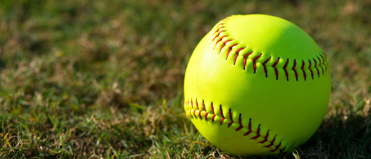 Softball Coach Sexually Abuse Two Girls | Optic yellow softball on grass Shutterstock/EHStockphoto