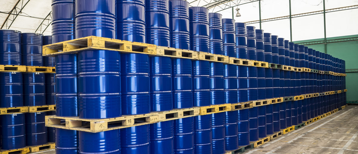 Oil drums stacked in storage. Shutterstock/Siwanan K