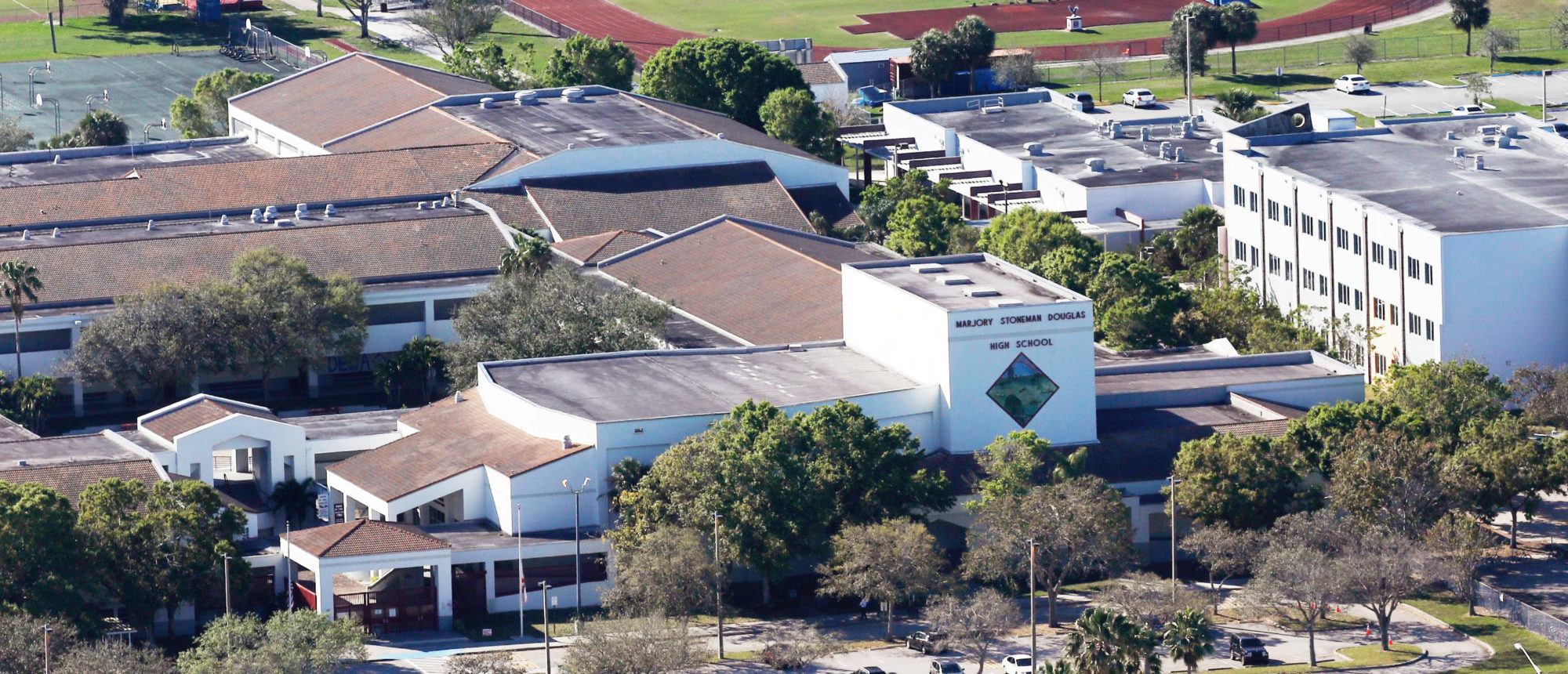 FILE PHOTO: An aerial view shows Marjory Stoneman Douglas High School following a mass shooting in Parkland, Florida, February 16, 2018. REUTERS/Carlos Garcia Rawlins/File Photo