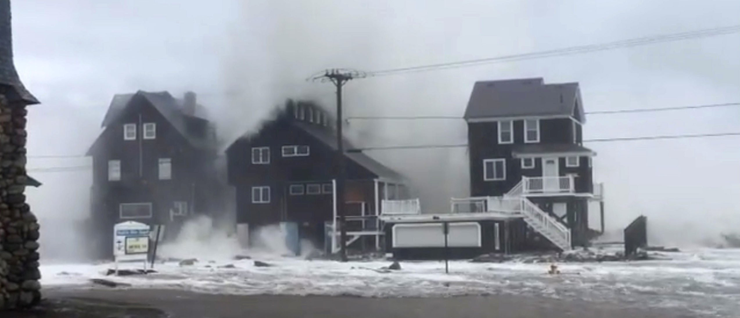 A wave crashes over a house after flooding and surge due to a winter nor'easter storm in Marshfield, Massachusetts, U.S. in this still image from video taken on March 3, 2018 obtained from social media. Instagram/JAMES KUKSTIS/via REUTERS