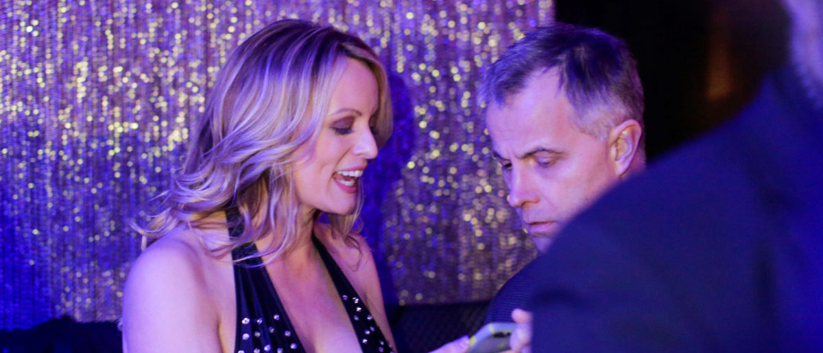 Adult-film actress Stephanie Clifford, also known as Stormy Daniels, speaks with supporters at the end of her striptease show at Gossip Gentleman club in Long Island, New York, U.S., February 23, 2018. REUTERS/Eduardo Munoz | Stormy Daniels Says She's Not A Victim