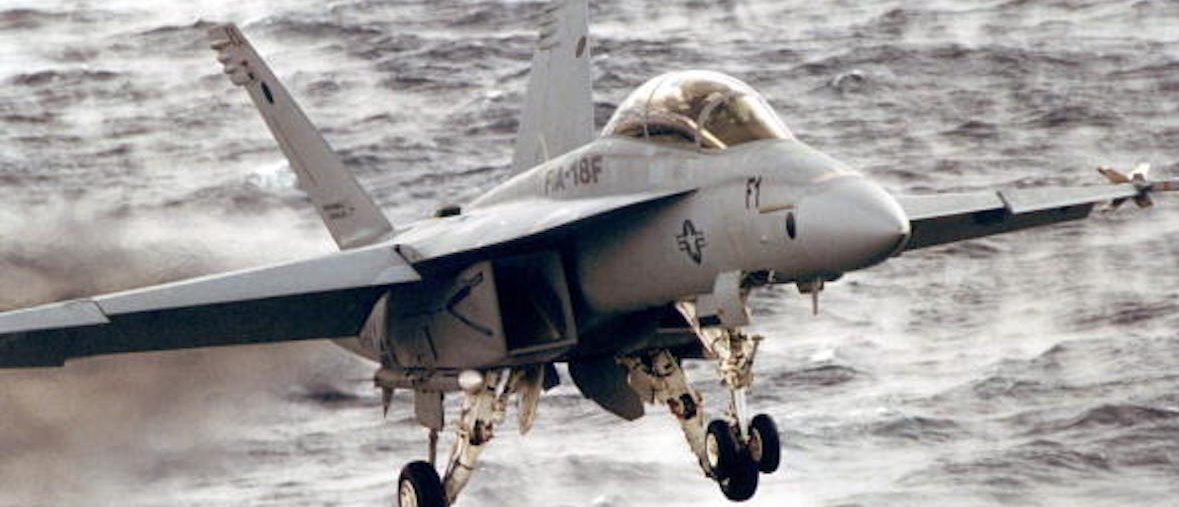"AT SEA - JANUARAY 18: A F/A-18F ""Super Hornet"" fighter plane comes in for a landing January 18, 1997 aboard the USS John C. Stennis. Two U.S. Navy F/A-18 ""Super Hornets"" crashed in the Pacific Ocean October 18, 2002 about 80 miles southwest of Monterey, California, according to Pentagon officials. Officials have no word on the cause of the crash. The jets had flown from Lemoore Naval Air Station in California, which is about an hour south of Fresno, on a routine training mission. The U.S. Coast Guard is searching for the four aviators onboard. (Photo by U.S. Navy/ Airman Recruit Adam Plantz/Getty Images)"