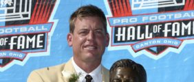 CANTON, OH - AUGUST 05:  Quarterback Troy Aikman of the Dallas Cowboys poses with his bust after his induction during the Class of 2006 Pro Football Hall of Fame Enshrinement Ceremony at Fawcett Stadium on August 5, 2006 in Canton, Ohio.  (Photo by Doug Benc/Getty Images)
