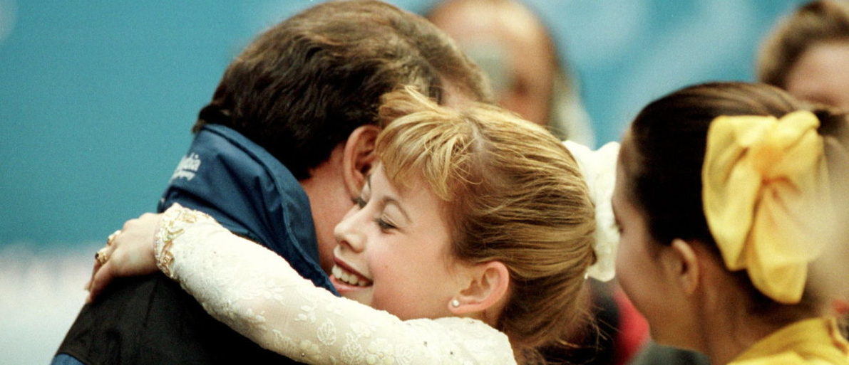 Tara Lipinski of the U.S. gives her coach Richard Callaghan a hug after performing her free program at the World Figure Skating Championships in Lausanne March 22. Lipinski, aged 14 , today became the youngest champion in the history of the event. (Photo: Reuters/ Kevin Lamarque)