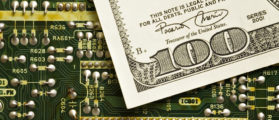 Earning cash from technology/Investing in technology. (Shutterstock)