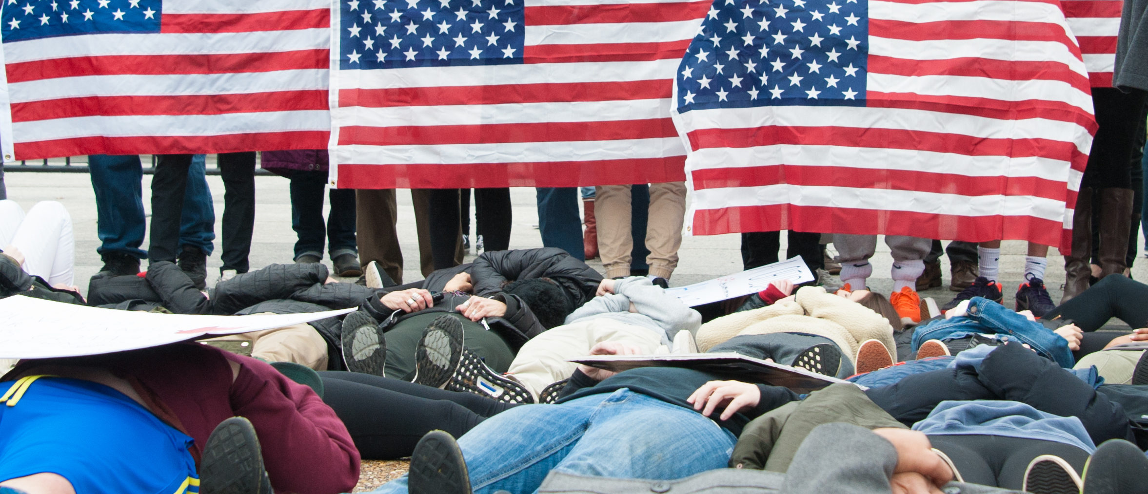 Teenagers stage a lie-in at the White House to protest gun laws (Shutterstock/Rena Schild)