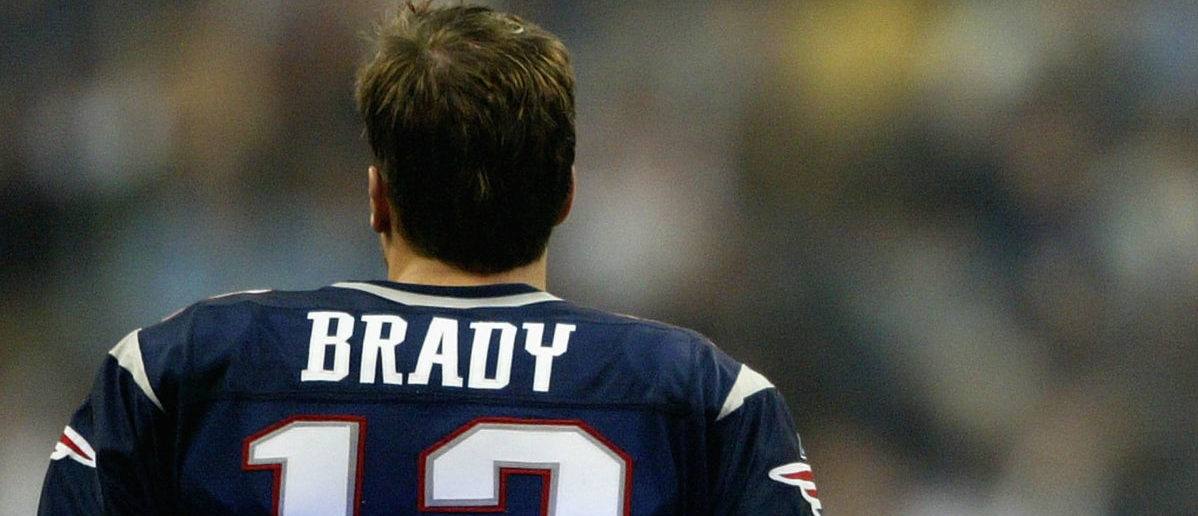 Quarterback Tom Brady #12 of the New England Patriots looks on before Super Bowl XXXVIII against the Carolina Panthers at Reliant Stadium on February 1, 2004 in Houston, Texas. (Photo by Andy Lyons/Getty Images)